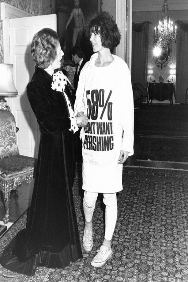 Katharine Hamnett wearing self designed  statement shirt meeting Thatcher.