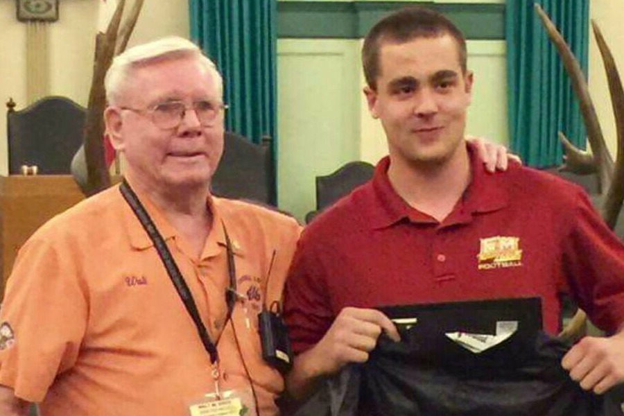 Dalton Saunders (right) stands with a member of the Orange Elks Lodge #1475 (left) (Photo via @elmodenafb on Twitter).