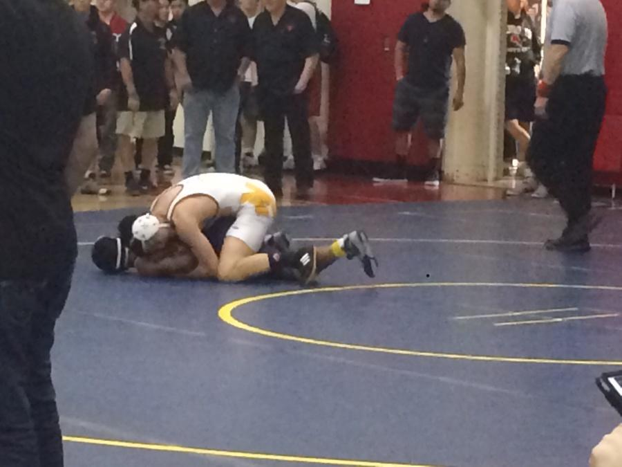 Getting Down and Dirty: Huang wrestling at Westminster High School.