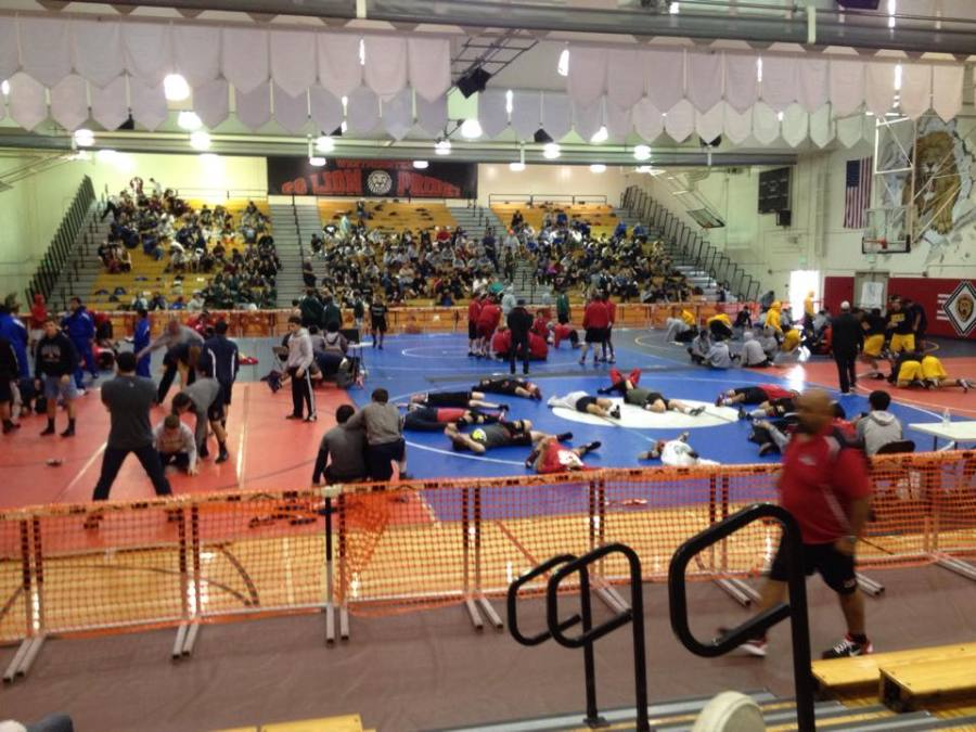 Escaping Reality: The wrestlers take a break from school as they warm-up for their Westminster Tournament.