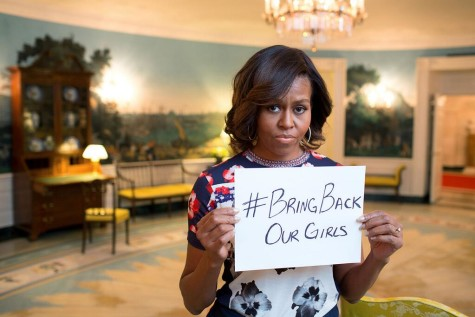 Michelle Obama holds sign: #BringBackOurGirls
