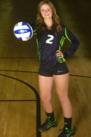 Freshman Hailey Gray posing for her club volleyball pictures.