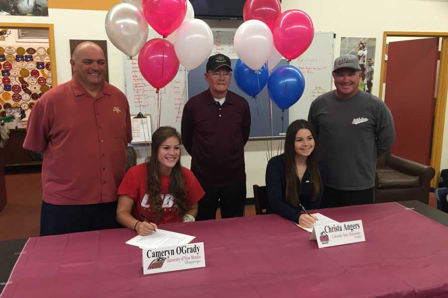 Seniors Cameryn O'Grady (left) and Christa Angers (right) officially committing to the University of New Mexico and Colorado State University-Pueblo for softball