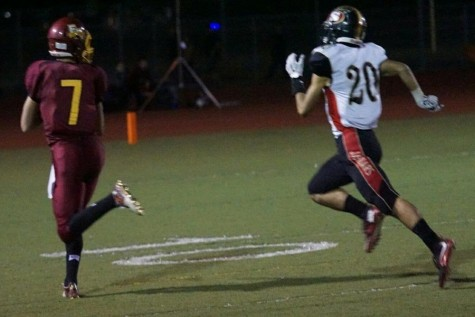 Senior Greg Lamb out runs a defender in El Mo's route of Segerstrom 47-27.