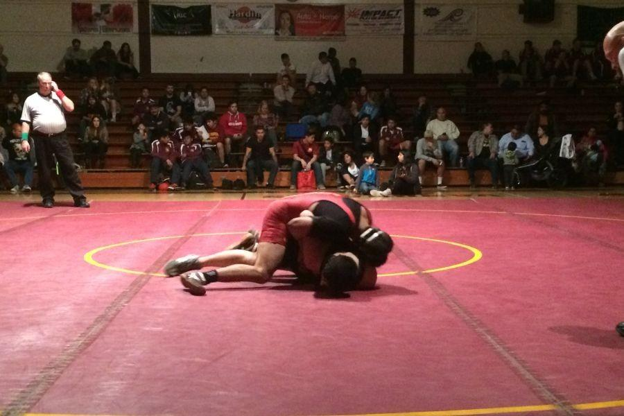 Pin for the Win: Perez holds down his opponent right before his pin.