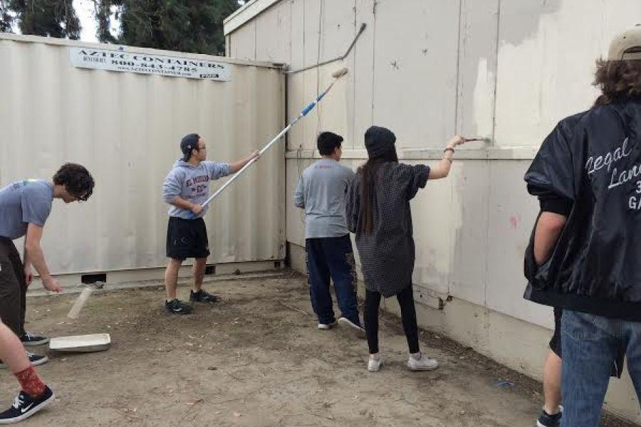 A Clean School is a Happy School: Some ASB members painting the side of Coach D's office.