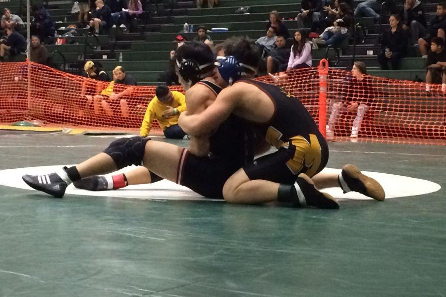 For the Takedown: Van Ligten beats opponent from Ayala High School.