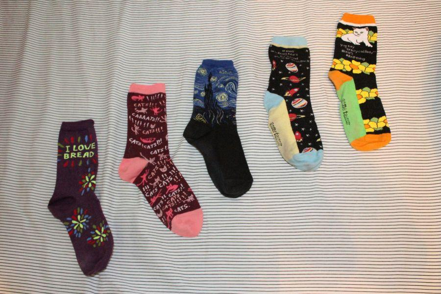 Several socks from Blue Q, Hot Sox, and Anne Taintor