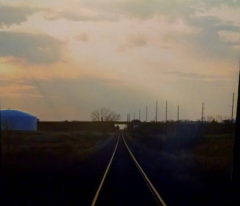 The empty railroad portrays the rustic mood of the album