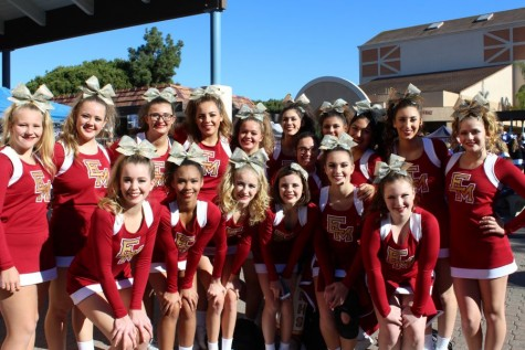 Cheerleaders stopping for a picture after one of their competitions.
