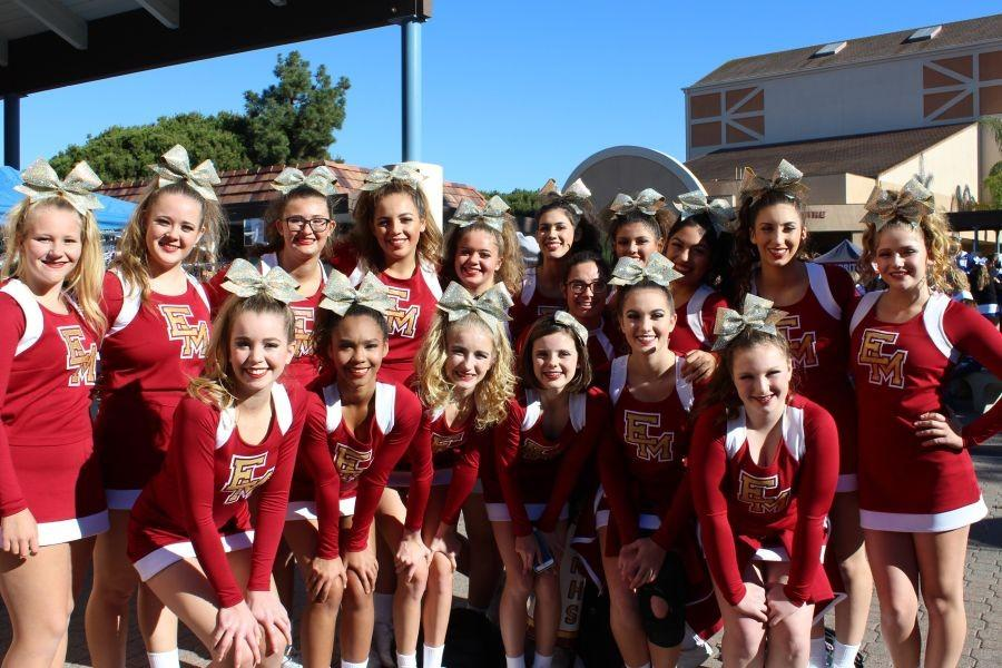 Cheerleaders+stopping+for+a+picture+after+one+of+their+competitions.