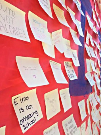 The Power of the  Positivity: PAL distributed sticky notes to the students to write influential messages to stick on a poster in the quad on Thursday, March 31.