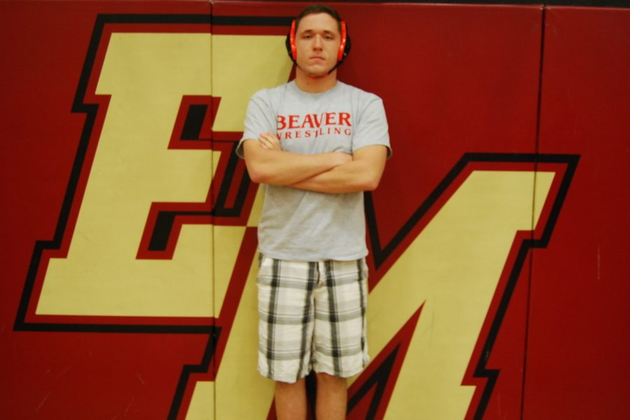 Senior+Andrew+Helfrich+poses+in+front+on+the+iconic+%22EM%22+logo+for+his+College+Commitment+photo+shoot.+