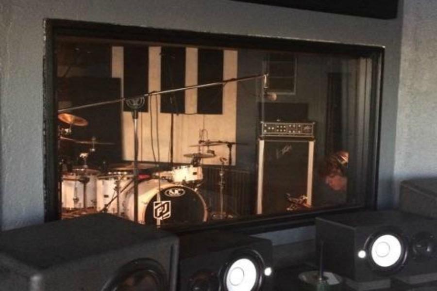 PJ's drum set in recording booth.