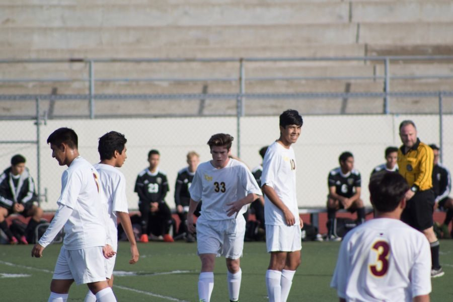 players celebrating after scoring against Foothill