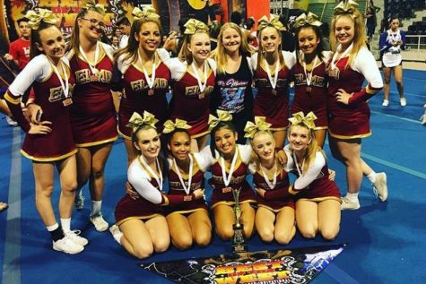 Competition cheer poses with their first place medals and trophy after the Best of the West competition.