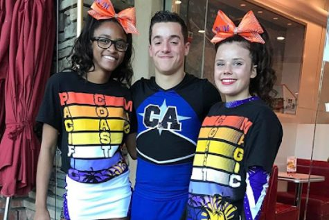 K'yla Daniels (left) and Maddie Warren (right) pose in their PCM Divine uniforms next to a friend from another team.