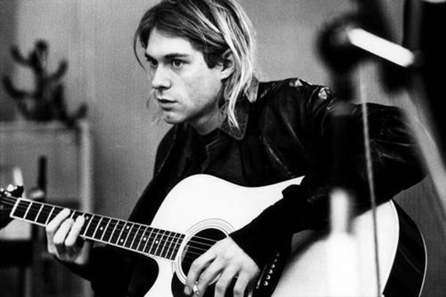 NETHERLANDS - NOVEMBER 25:  HILVERSUM  Photo of Kurt COBAIN and NIRVANA, Kurt Cobain recording in Hilversum Studios, playing Takamine acoustic guitar. His suicide was one of the most rattling deaths of the 90s.