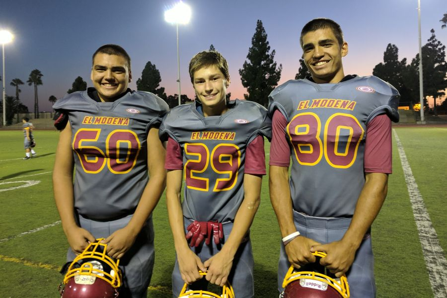 Senior TE/DT Luke Dunham (#80) with Sophomore DB/WR Andrew Tierney (#29) and Sophomore OL/DL Zack Dunham (#60)