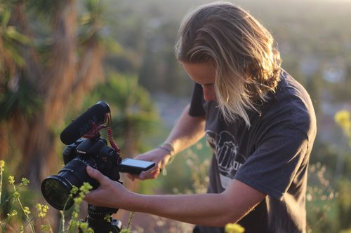 Wallace in the midst of photographing the natural world (Photo via William Wallace).