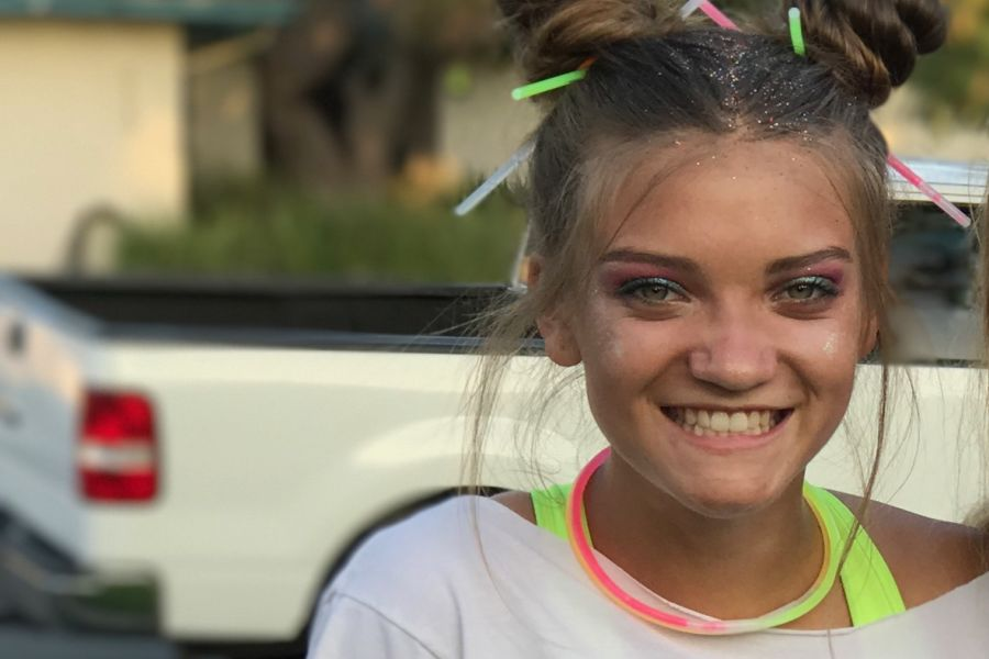 Anna Smith(10) gets ready for Glow in the Dark themed dance on Friday night.