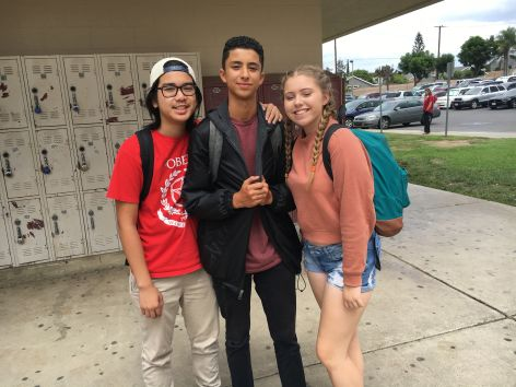 Maverick Cruz, Jacob Rodriguez, and Avery Miles (left to right) smile after a successful club rush