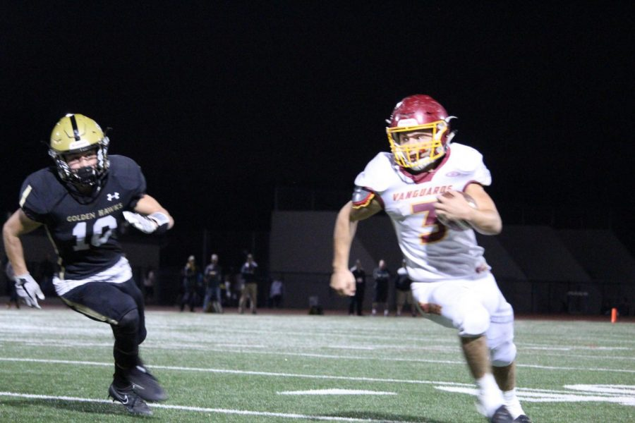 Senior, Andrew Carvajal (#3), escapes from an El Dorado defense.