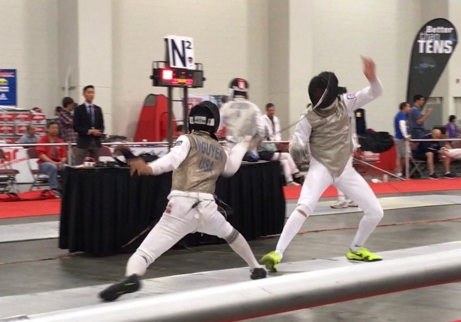 Jett Nguyen fencing at the Utah national fencing competition