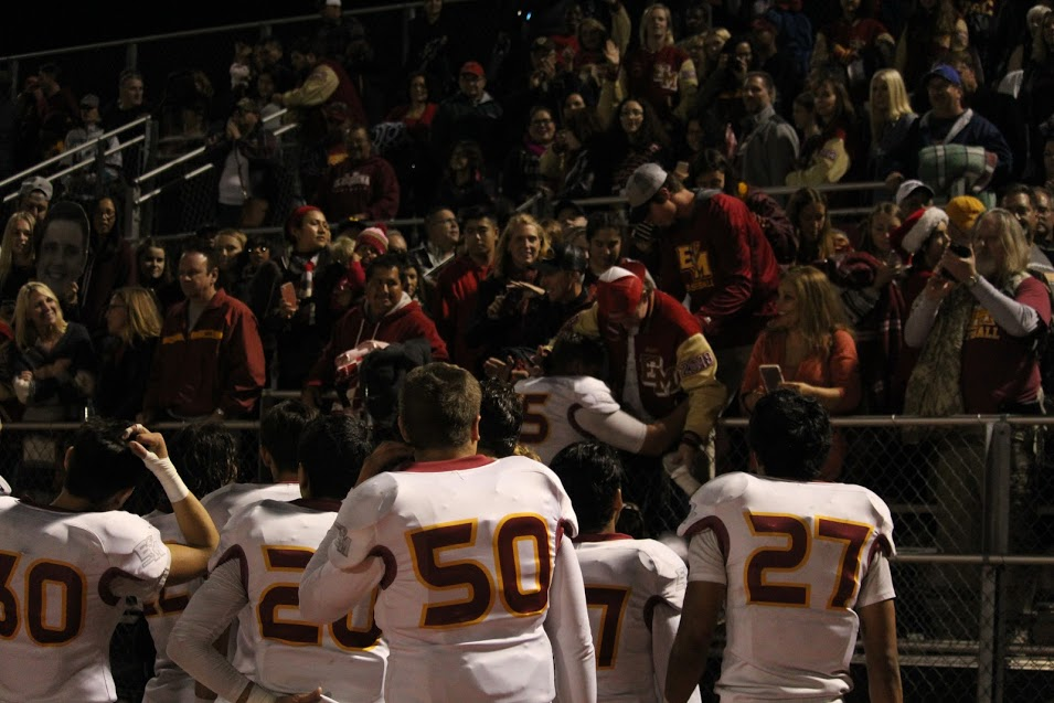 Senior Owen Marcyan (75) hugs senior Ryan Macmillan after El Modena football wins the CIF Championship game against Don Lugo.