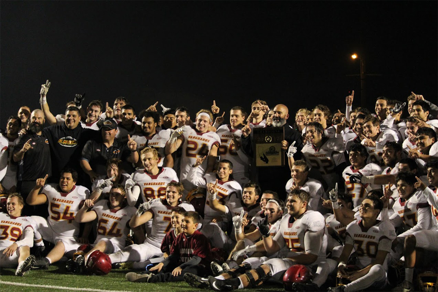 the El Modena football team poses with their new hardware