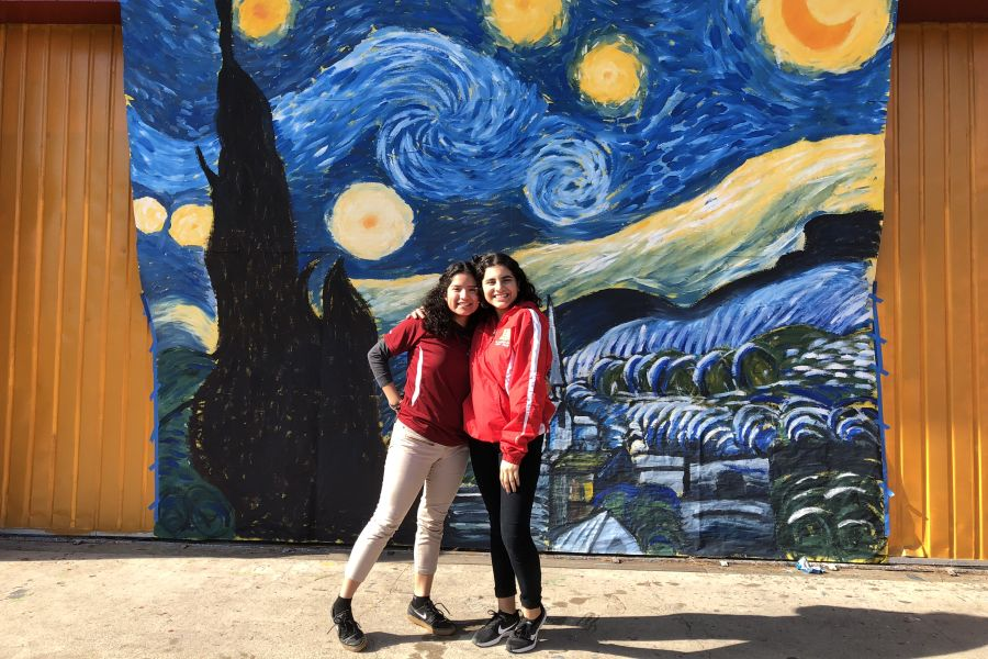 Baltazar (left) and Sustaeta (right) pose in front of their most recent mural.