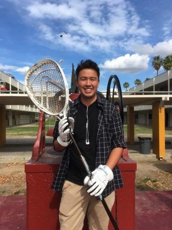 Captain, Dylan Zamora, poses with his Lacrosse stick.