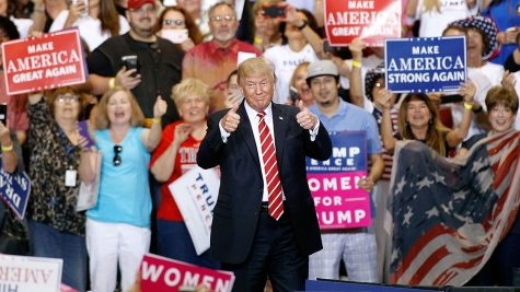 PHOENIX, AZ - AUGUST 22:  U.S. President Donald Trump gives a thumbs up to a crowd of supporters at the Phoenix Convention Center during a rally on August 22, 2017 in Phoenix, Arizona.  (Photo by Ralph Freso/Getty Images)