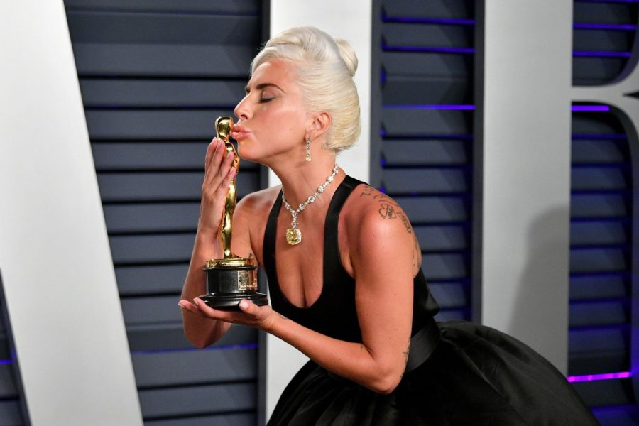 Lady Gaga kisses her hard-earned Oscar