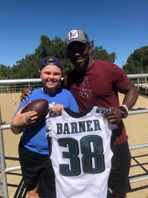 Texas Huckabey with NFL Runningback Kenjon Barner